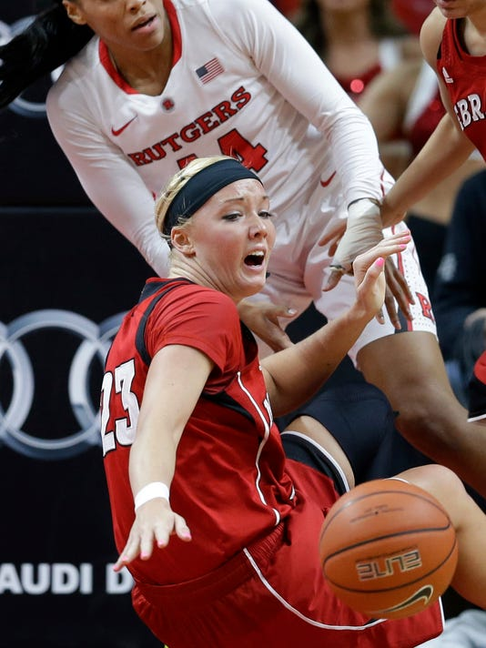 Nebraska forward Emily Cady (23) reaches for the ball as she falls after colliding with Rutgers forward Betnijah Laney, top, during the first half of an NCAA college basketball game Thursday, Feb. 5, 2015, in Piscataway, N.J. (AP Photo/Mel Evans)