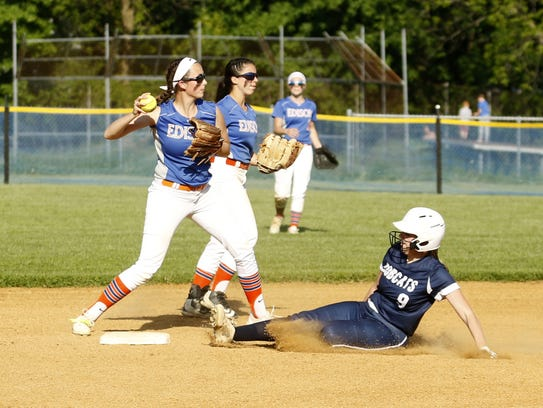 Thomas A. Edison's Haley Maggs looks to first after