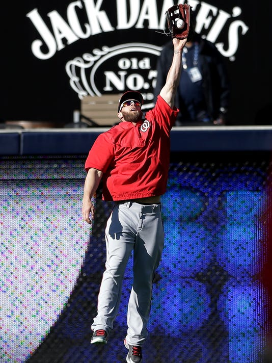 Washington Nationals right fielder Bryce Harper makes a leaping catch during batting practice before facing the San Diego Padres in a baseball game Friday, May 15, 2015, in San Diego. (AP Photo/Gregory Bull)