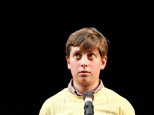 A contestant looks up before he starts to spell his word during the Countywide Spelling Bee at Hartnell Community College on Sunday, March 4, 2018 in Salinas.