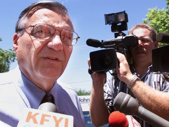 Maricopa County Sheriff Joe Arpaio talks to reporters