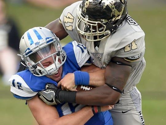 Vanderbilt linebacker Zach Cunningham (41) wraps up