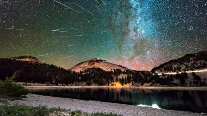 University Preparatory School science teach Cory Poole took this photo of last year's Perseid meteor shower over Lake Helen at Lassen Volcanic National Park.