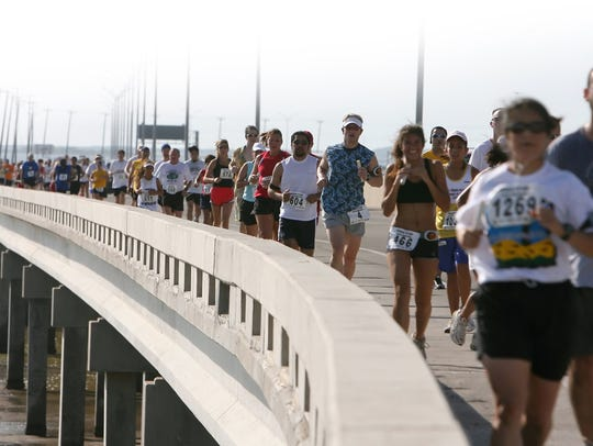 Runners in the third leg of the 31st annual Beach to
