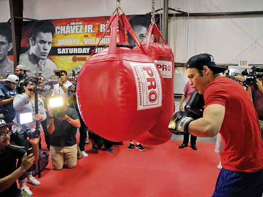 Julio Cesar Chavez Jr. hits several punching bags during a short workout for the press Wednesday afternoon at Redstar Fitness Center. Chavez Jr., will face challenger Marcos Reyes in the main event Saturday night at the Don Haskins Center on a live Showtime boxing card.