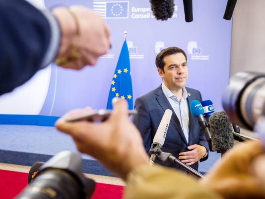 Greek Prime Minister Alexis Tsipras speaks with the media Monday after a meeting of eurozone heads of state at the EU Council building in Brussels.