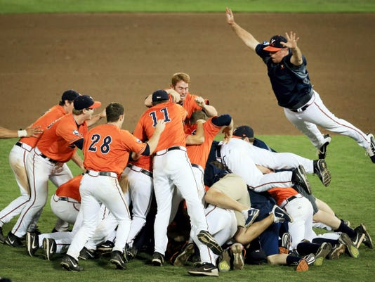 Virginia players celebrate Wednesday after beating Vanderbilt, 4-2, in Game 3 of the College World Series finals at TD Ameritrade Park in Omaha, Neb.