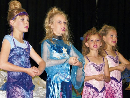 """The mermaid sisters sing during the Stout Elementary School production of """"The Little Mermaid"""" on Tuesday. Mermaids are, from left, Mackenzie Johnson, first grade, Ruby Herd, fourth grade, Grace Montoya, first grade, and Makayla Walls, first grade. Randal Seyler - Sun-News"""
