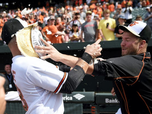 Baltimore's Steve Pearce, left, gets a pie in the face from teammate Tommy Hunter after Monday's 4-3 win over Houston. Pearce had a two-run homer.