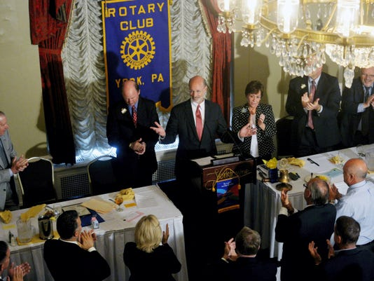 Gov. Tom Wolf acknowledges a standing ovation before his guest speech at a Rotary Club of York meeting on Wednesday at The Yorktowne Hotel. Wolf's father, Bill, used to be president of the club.