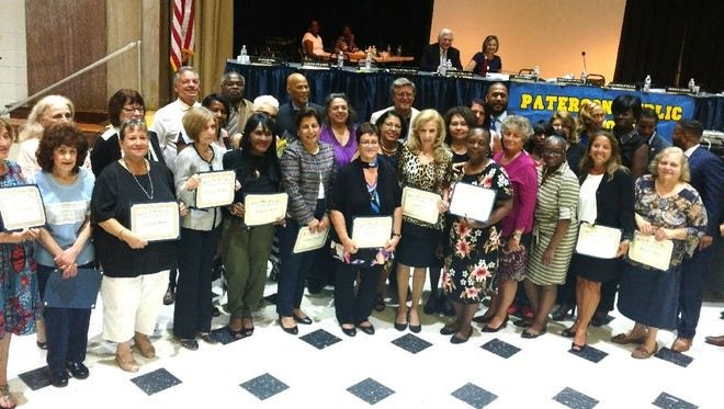 Honorees celebrate their service at the Sept. 20 Paterson school board meeting.