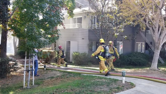 Crews help fight a fire on the second floor of an apartment building Friday morning in Ventura.