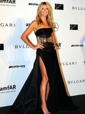 Heidi Klum arrives for the amfAR charity dinner during the fashion week in Milan, Italy, Saturday, Sept. 20, 2014.