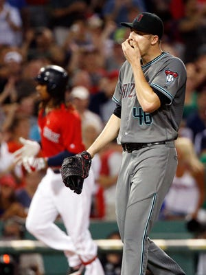 Arizona Diamondbacks' Patrick Corbin reacts after giving up a three-run homer to Boston Red Sox's Hanley Ramirez, left,  during the second inning of a baseball game in Boston, Friday, Aug. 12, 2016.