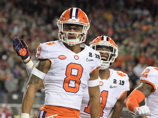 Jan 7, 2019; Santa Clara, CA, USA; Clemson Tigers cornerback A.J. Terrell (8) celebrates with safety Isaiah Simmons (11) after scoring on an interception return in the first quarter against the Alabama Crimson Tide during the 2019 College Football Playoff Championship game at Levi's Stadium. Mandatory Credit: Kirby Lee-USA TODAY Sports