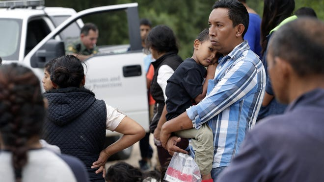 Families who crossed the nearby U.S.-Mexico border near McAllen, Texas, wait for Border Patrol agents to check names and documents. Immigration authorities say they expect the ongoing surge of Central American families crossing the border to multiply in the coming months.