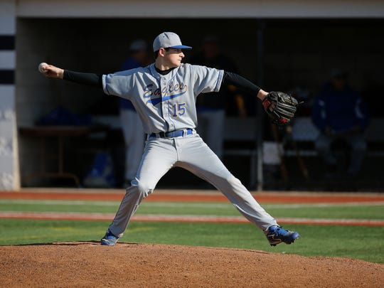Irondequoit starting pitcher Chris Butler delivers