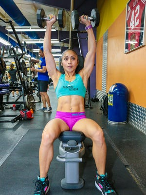 Rhea Macaluso does shoulder presses during training at Paradise Fitness Center in Hagatna on Aug. 18. Rudy Capistrano/For PDN