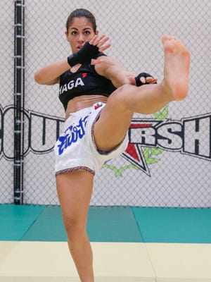 MMA fighter Brogan Walker practices her punches and kicks at IFit Guam Gym in Tamuning on Aug. 1.