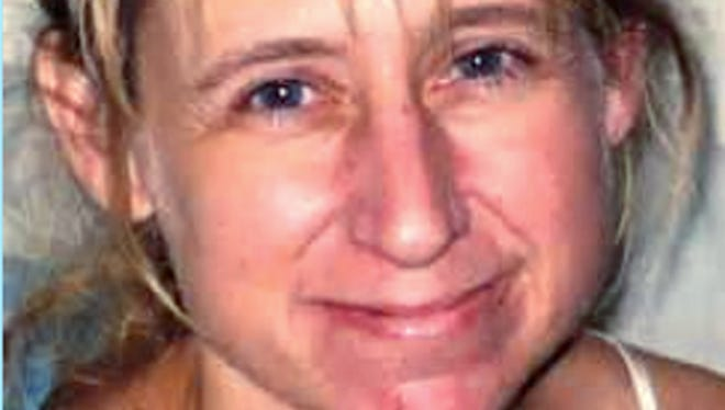 An undated photo of Laura Simonson, 37, of Farmington, Minn. Authorities said Wednesday that a man was arrested in connection with the killing of Simonson, one of two women whose bodies were discovered June 5 in two suitcases discarded along a rural road in the town of Geneva in Walworth County in southern Wisconsin. Authorities have not identified the remains of the second female.