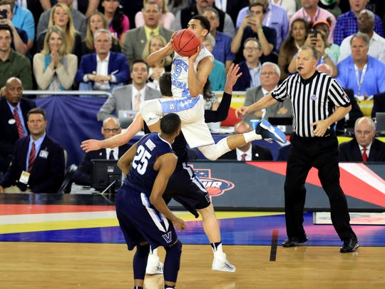 North Carolina's Marcus Paige shoots a three-pointer to tie the game with 4.7 seconds left in the second half against the Villanova Wildcats Monday in Houston.