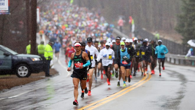 Runners endured cold, wet conditions in the 122nd Boston Marathon on Monday, April 16, 2018.