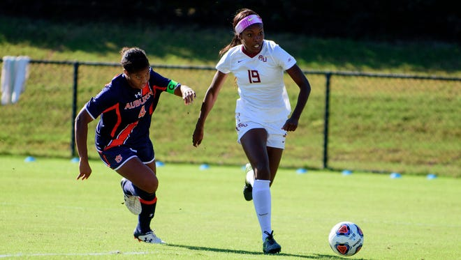 Cheyna Williams races past an Auburn defender during FSU's 2-0 victory propelling them into the Elite Eight of the NCAA Tournament.