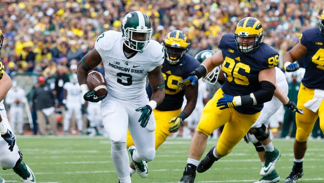 Michigan State Spartans running back LJ Scott (3) rushes for a touchdown in the first half against the Michigan Wolverines at Michigan Stadium.