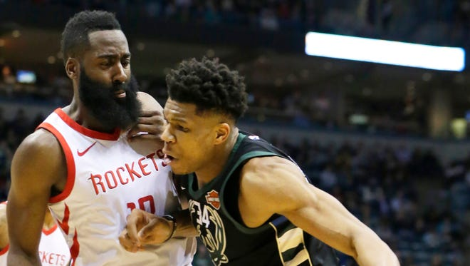 Bucks forward Giannis Antetokounmpo finds little room to move against Rockets guard James Harden during the second half of their game Wednesday at the BMO Harris Bradley Center.