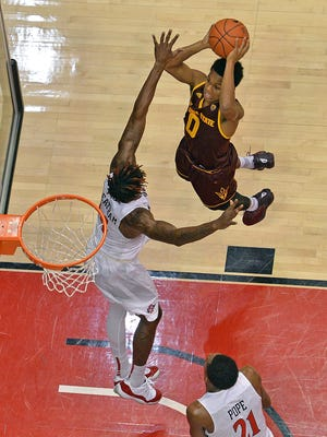 Arizona State Sun Devils guard Tra Holder (0) shoots as San Diego State Aztecs forward Zylan Cheatham (14) defends during the first half at Viejas Arena at Aztec Bowl, Dec. 10, 2016 in San Diego, Calif.