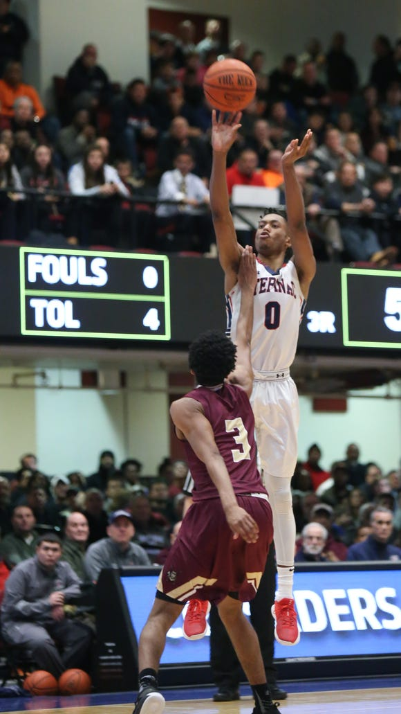 Stepinac's Alan Griffin (0) puts up a shot over Iona's