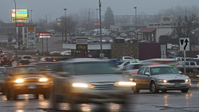 A motorist in the westbound lane waits to turn left onto Cleveland Avenue from East 10th Street Jan. 20 in Sioux Falls.