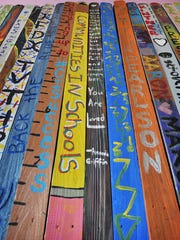 Hundreds of colorful, painted fence pickets will be