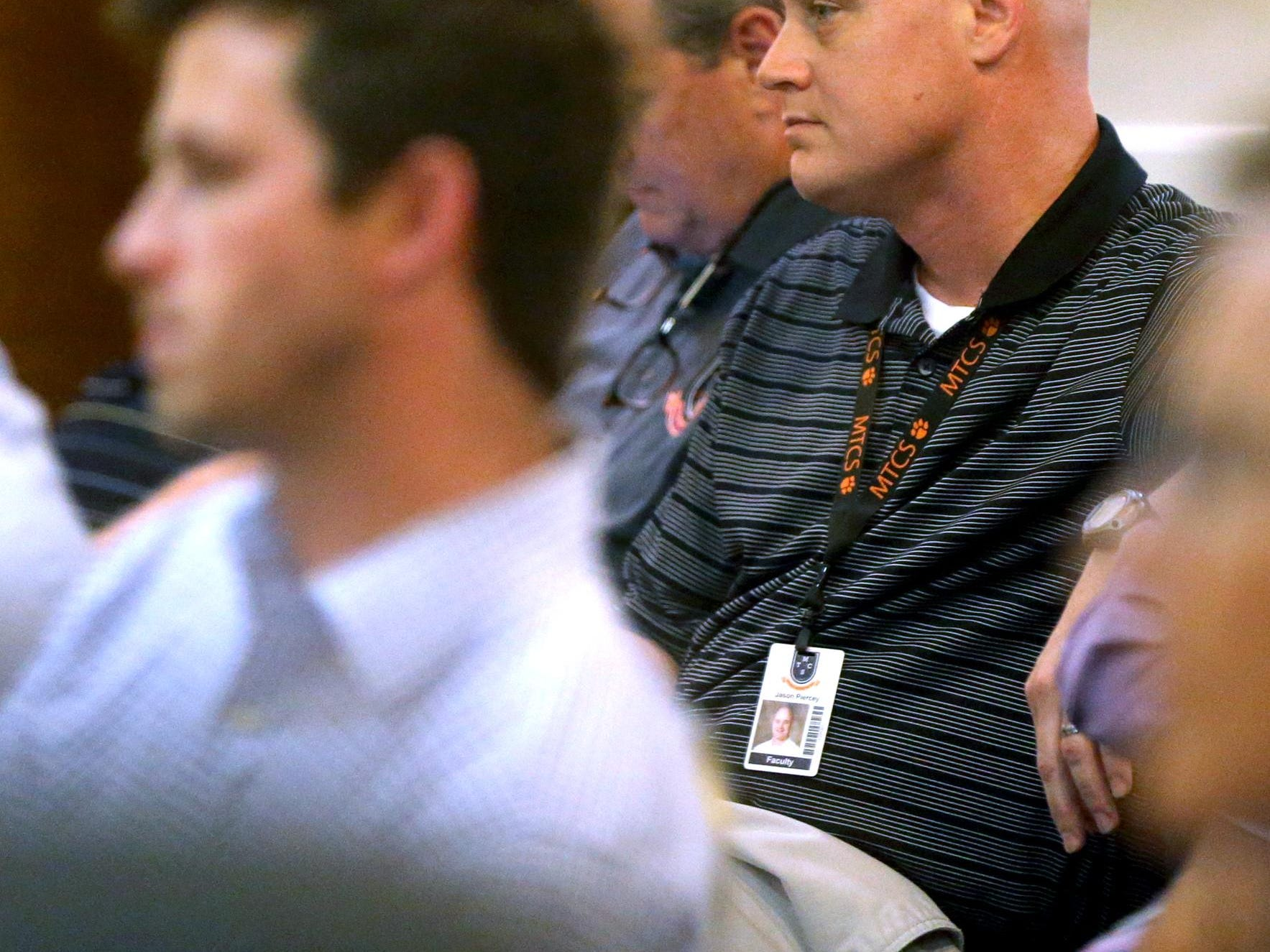 Jason Piercey, the boys basketball coach and athlectic director for MTCS, listens in on the TSSAA Legislative Council meeting at the DoubleTree Hotel in Murfreesboro on Thursday.