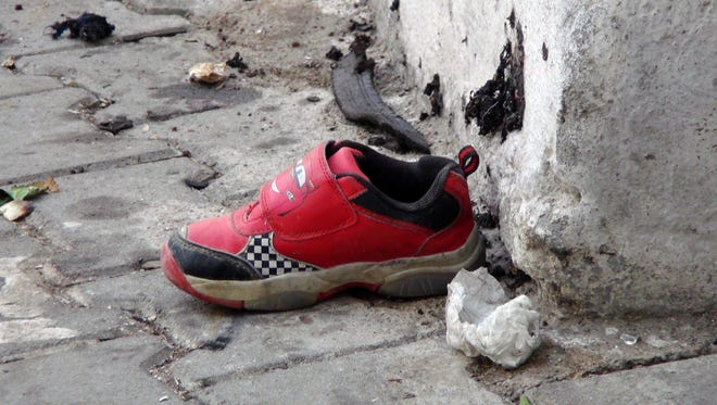 The shoe of a young victim and a piece of metal lay near the scene just hours after Saturday's bomb attack in Gaziantep, southeastern Turkey.