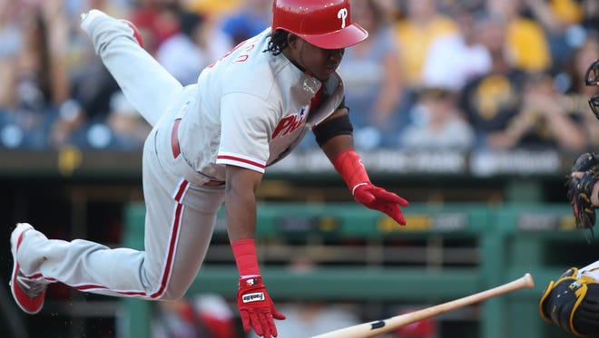 Philadelphia Phillies third baseman Maikel Franco reacts after being hit by a pitch from Pittsburgh Pirates starting pitcher Gerrit Cole (not pictured) during the first inning Friday at PNC Park. Franco was not in the lineup Saturday because of his sore wrist.