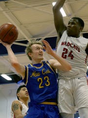 Newport Central Catholic's Jalen McDaniel drives to the basket against Newport's Tahj  Harding    the Wildcats 68-67 loss Friday,Feb. 23,2018.