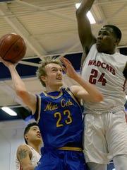 Newport Central Catholic's Jalen McDaniel drives to
