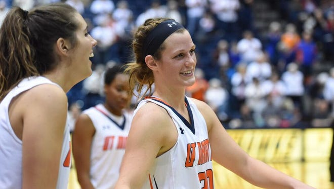 UTM senior Katie Schubert (center) shares a smile Saturday with Barianne Taylor as the Skyhawks beat Murray State 92-62.