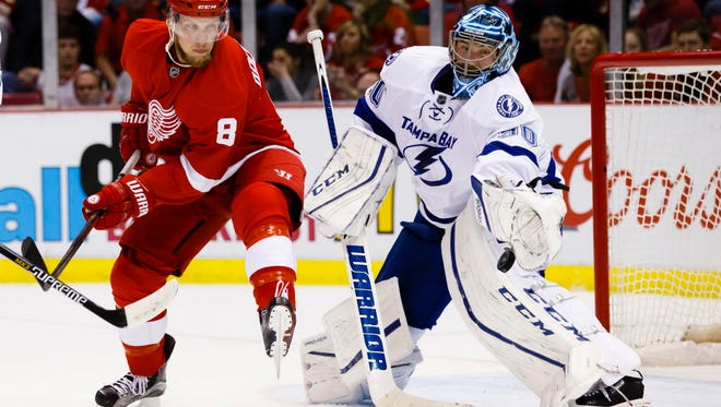 Goalie Ben Bishop, right, and the Tampa Bay Lightning eliminated the Red Wings in five games.