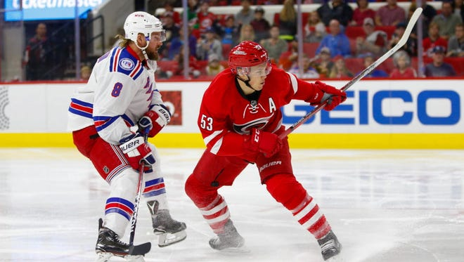 Hurricanes forward Jeff Skinner (53) scores in the second period against the Rangers.