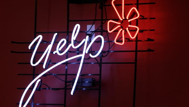 The logo of the online reviews website Yelp is shown in neon on a wall at the company's  Manhattan offices in New York.