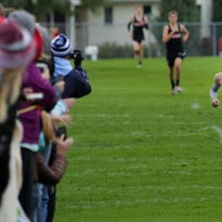 Luke Sampson of Little Chute wins the varsity race at the Kimberly Papermakers cross country invitational on Saturday at Kimberly.