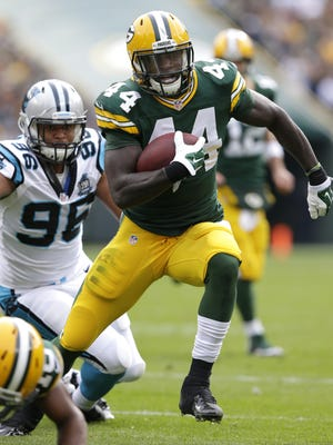 Green Bay Packers running back James Starks runs for a touchdown in the first quarter.  The Green Bay Packers host the Carolina Panthers Sunday, October 19, 2014, at Lambeau Field in Green Bay, Wis.  Wm. Glasheen/Post-Crescent Media