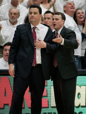 FILE - In this Feb.  19, 2011, file photo, Arizona coach Sean Miller, left, and his brother, coach Archie Miller.