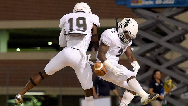 Delta State's Chris Robinson (2) celebrates his touchdown with John McInnis (19) on Saturday, September 30, 2017, at Mississippi College in Clinton, Miss.