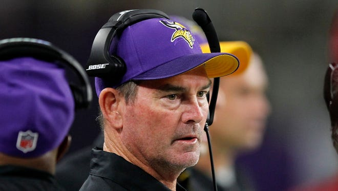 Minnesota Vikings head coach Mike Zimmer stands on the sidelines during the first half of an NFL football game against the Green Bay Packers Sunday, Sept. 18, 2016, in Minneapolis. (AP Photo/Andy Clayton-King)