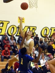 Dow Cameron goes up for a shot in traffic during Tri-Valley's