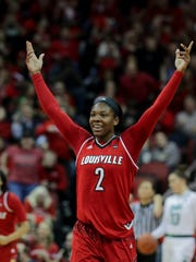 Louisville's Myisha Hines-Allen celebrates after scoring against Notre Dame.