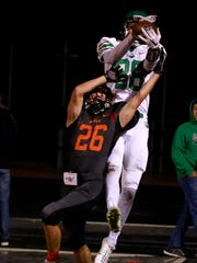 Farmington's Jacob Brown (88) breaks up a pass intended